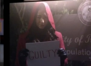 A-wears-an-emily-face-mask-and-red-coat-1-